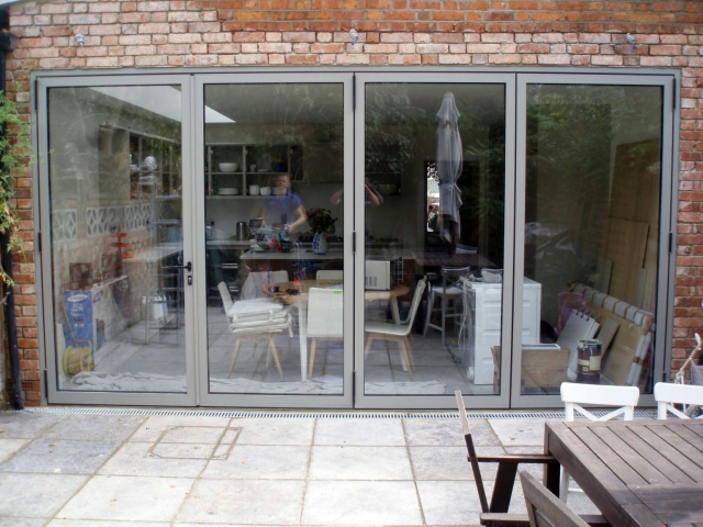 CF68 Bifolds in light grey manufactured by Southern Windows