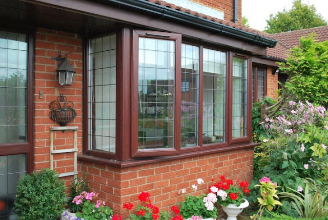 Casement windows in rosewood finish and leaded designs