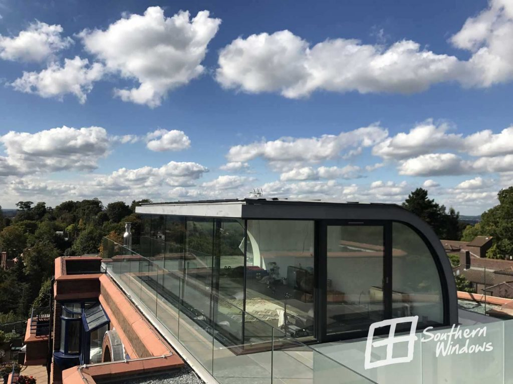 Large panoramic Schuco sliding doors in Hampstead Heath penthouse apartment - corner configuration