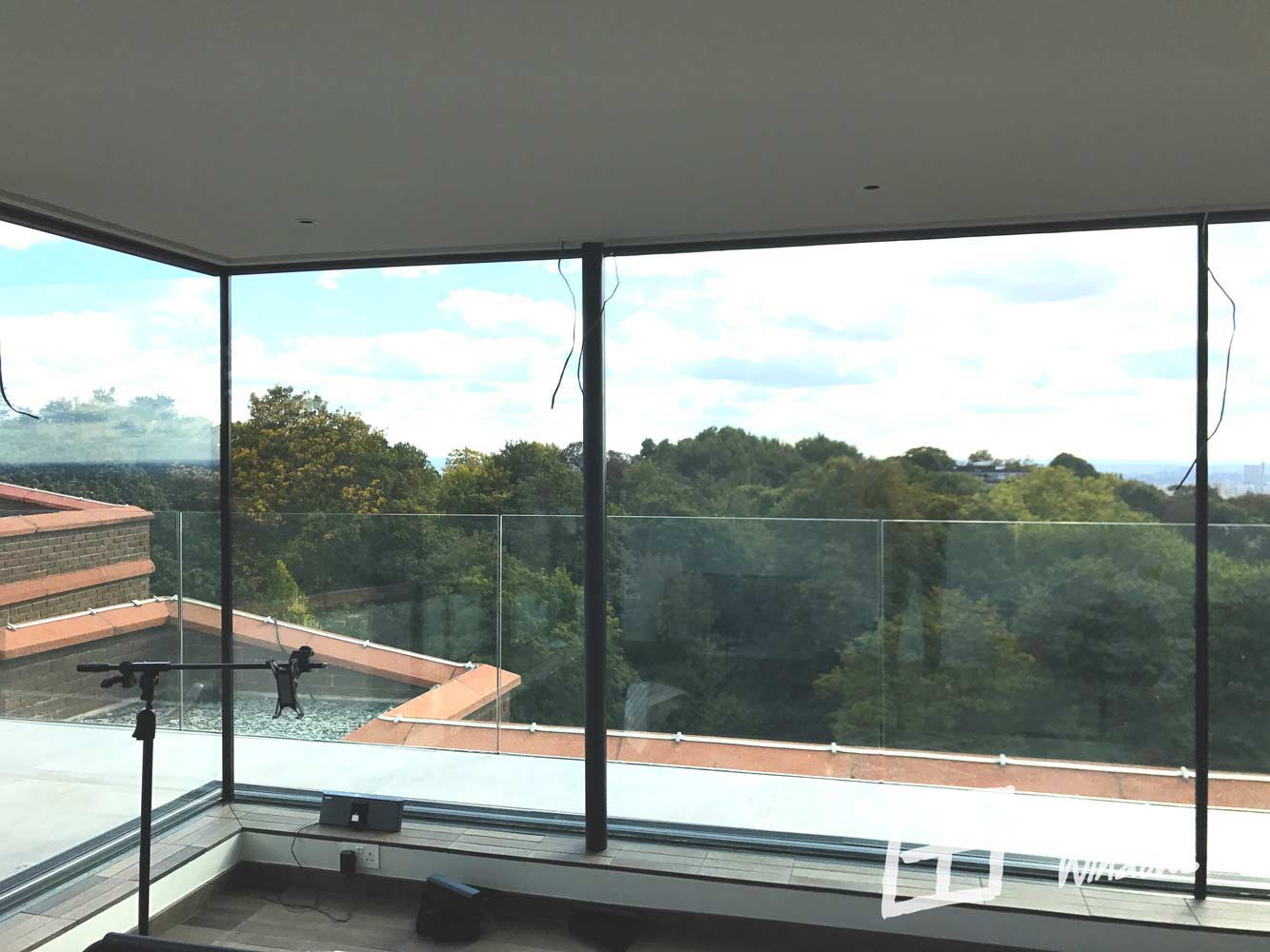 Large panoramic Schuco sliding doors in Hampstead Heath penthouse apartment - corner configuration