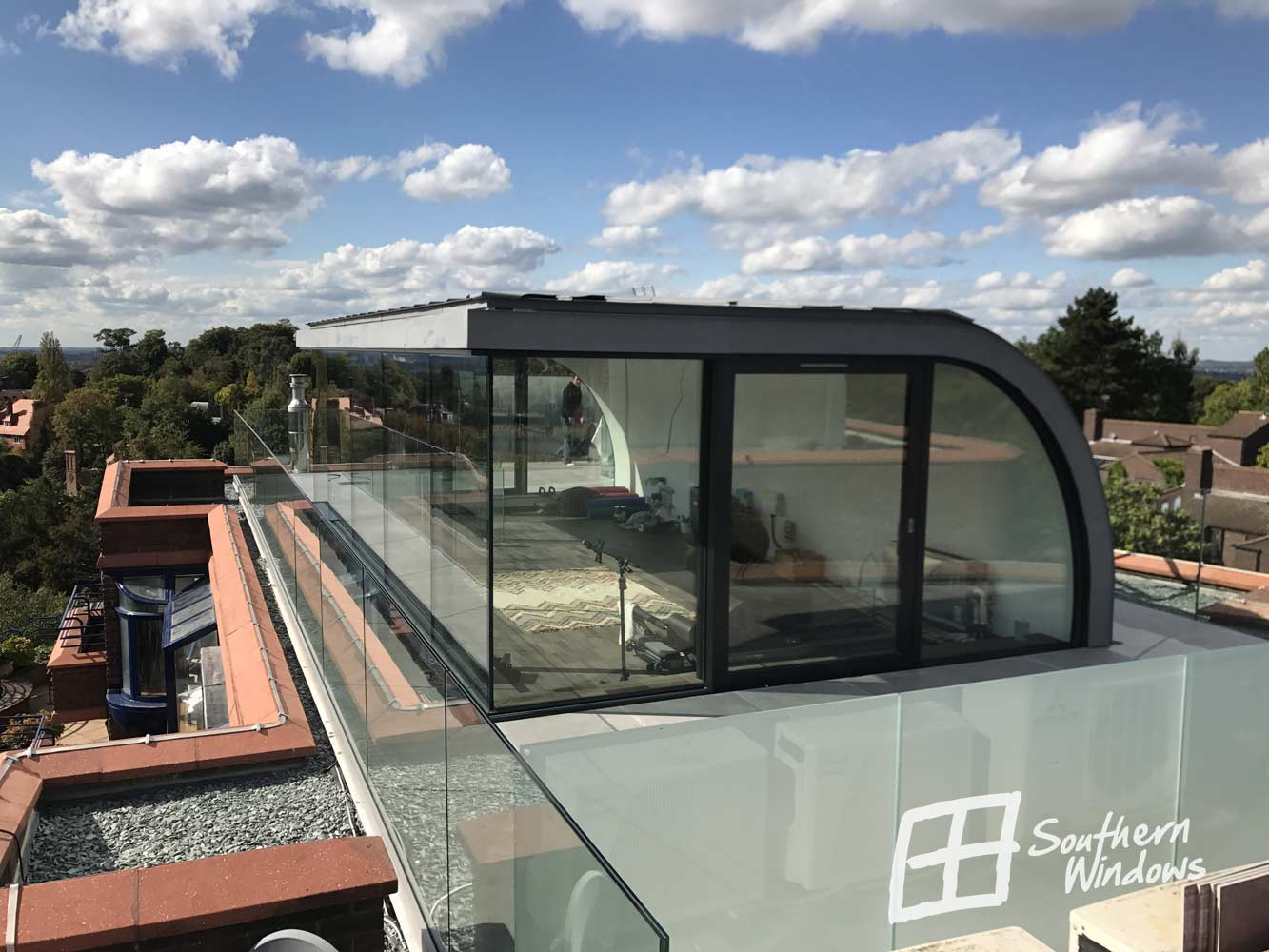 Large panoramic Schuco sliding doors in Hampstead Heath penthouse apartment