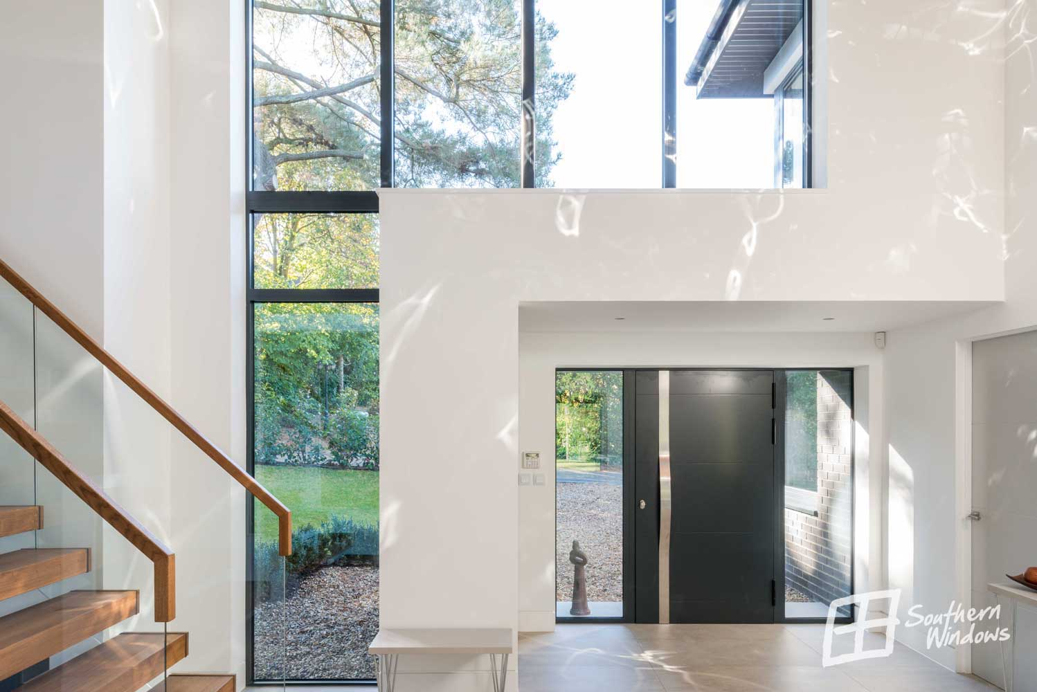 Double height glazing and entrance door with sidelights from Southern Windows