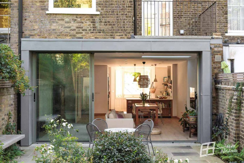 House extension with large sliding patio doors open to one side